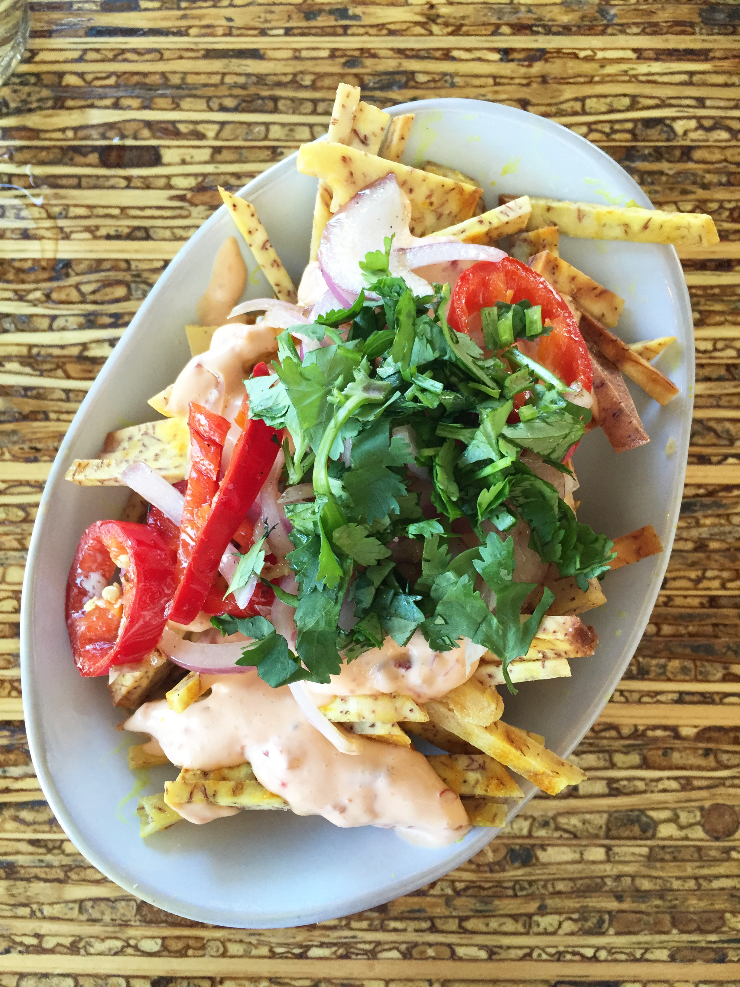Animal Fries - Taro fries with grilled onion, chilies, aioli, cilantro and shallots.