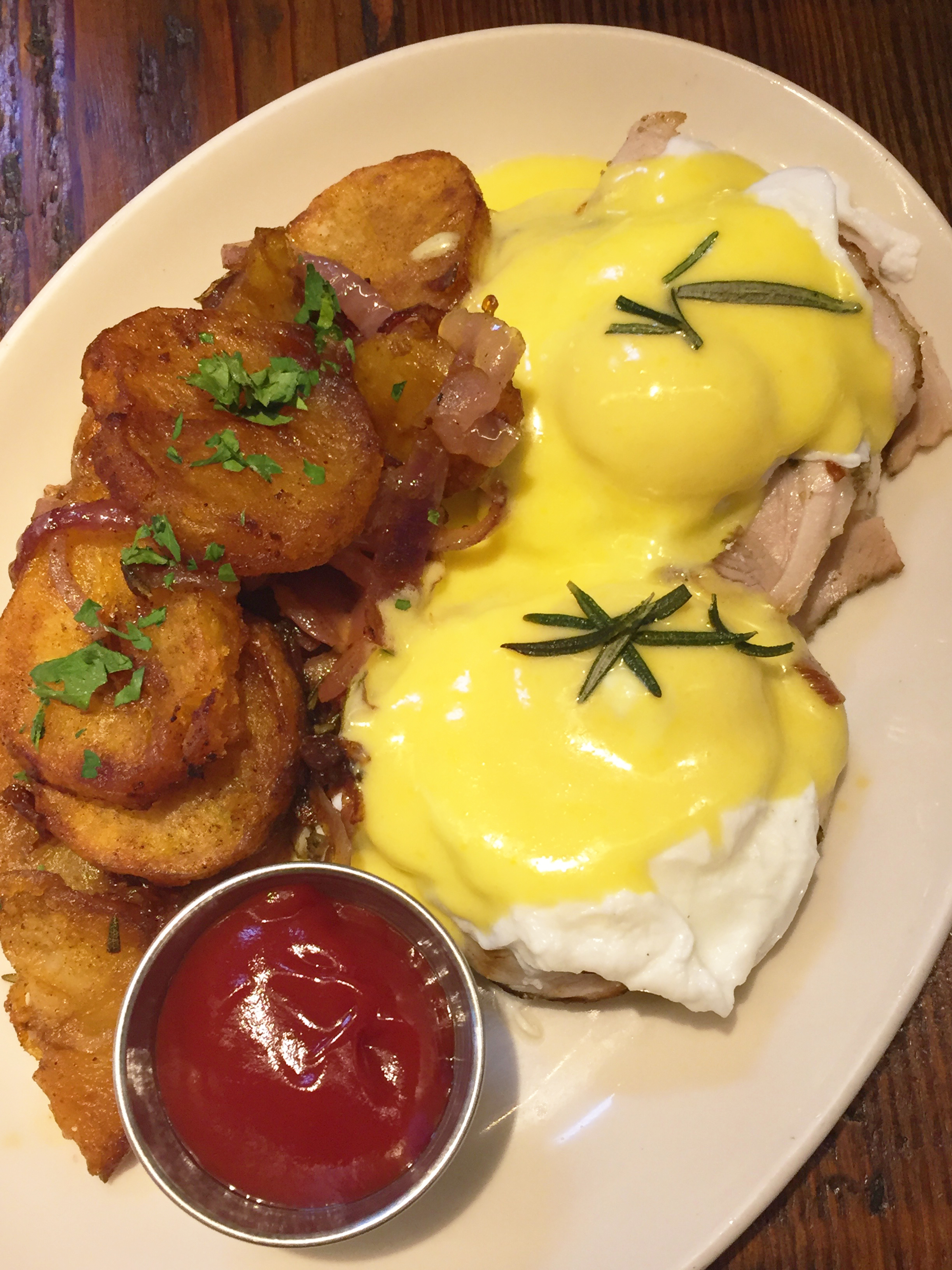 Porchetta eggs benedict, housemade english muffin, hollandaise, breakfast potatoes