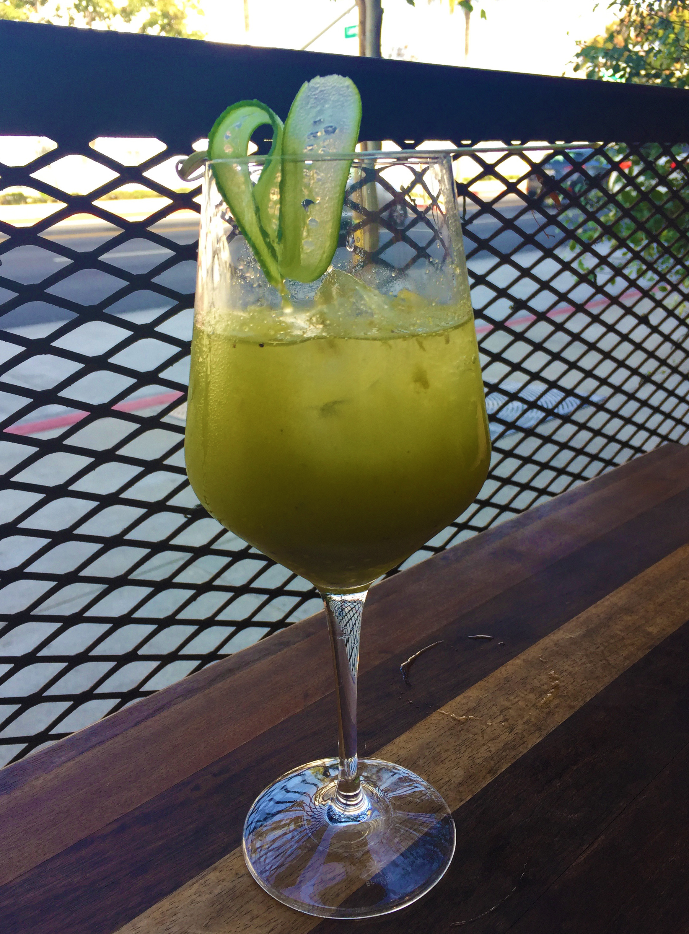 GREEN BLOODY MARY with cucumber, onion, celery, cilantro, parsley, fire roasted tomatillo, jalapeño