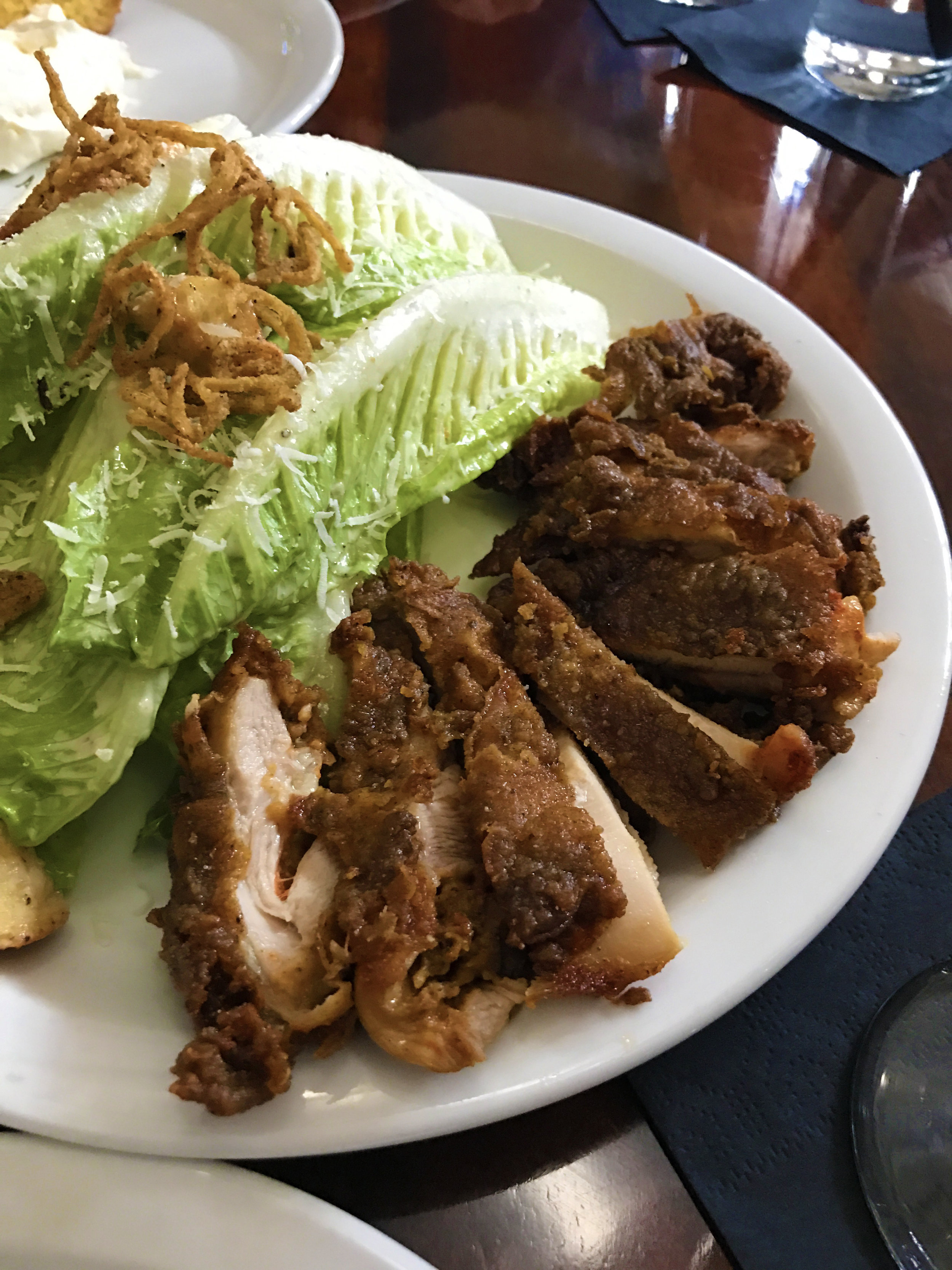 Romaine hearts with buttermilk Caesar, fried chicken, and crisp shallot