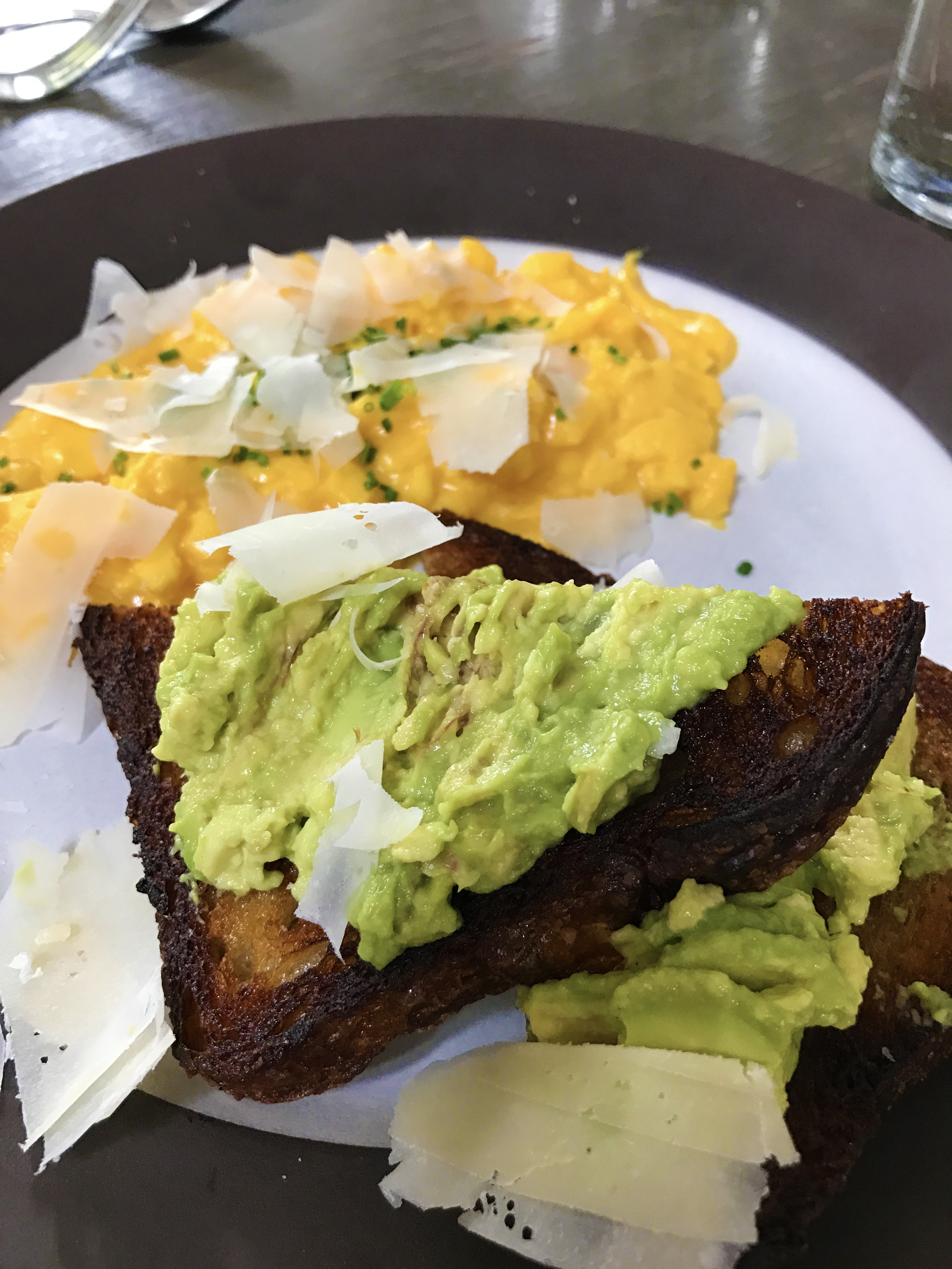 Soft scramble and avocado toast with parmesan and chives
