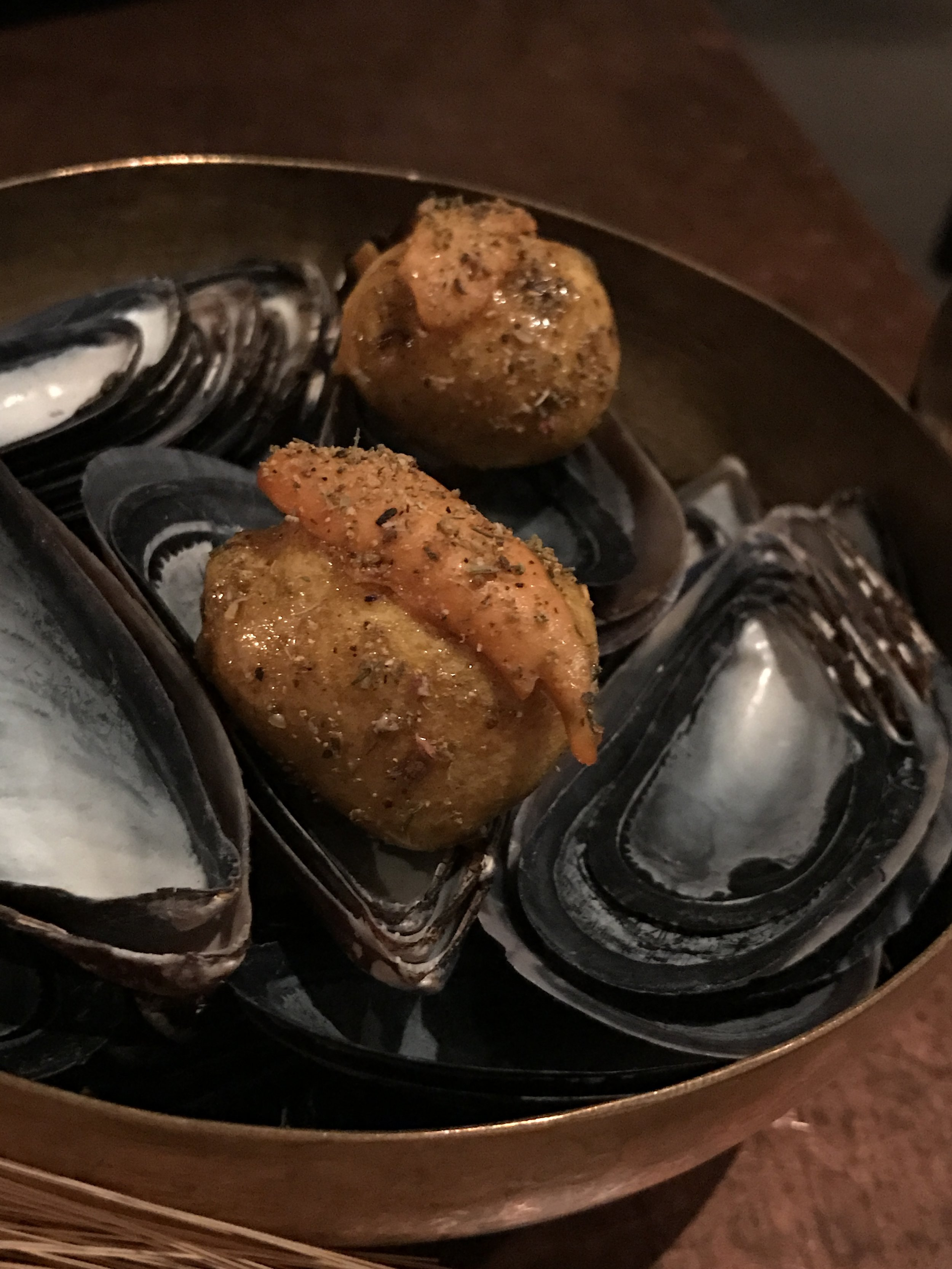 """Mussels """"croquette"""" with hints of anise, saffron, lardo, and honey"""
