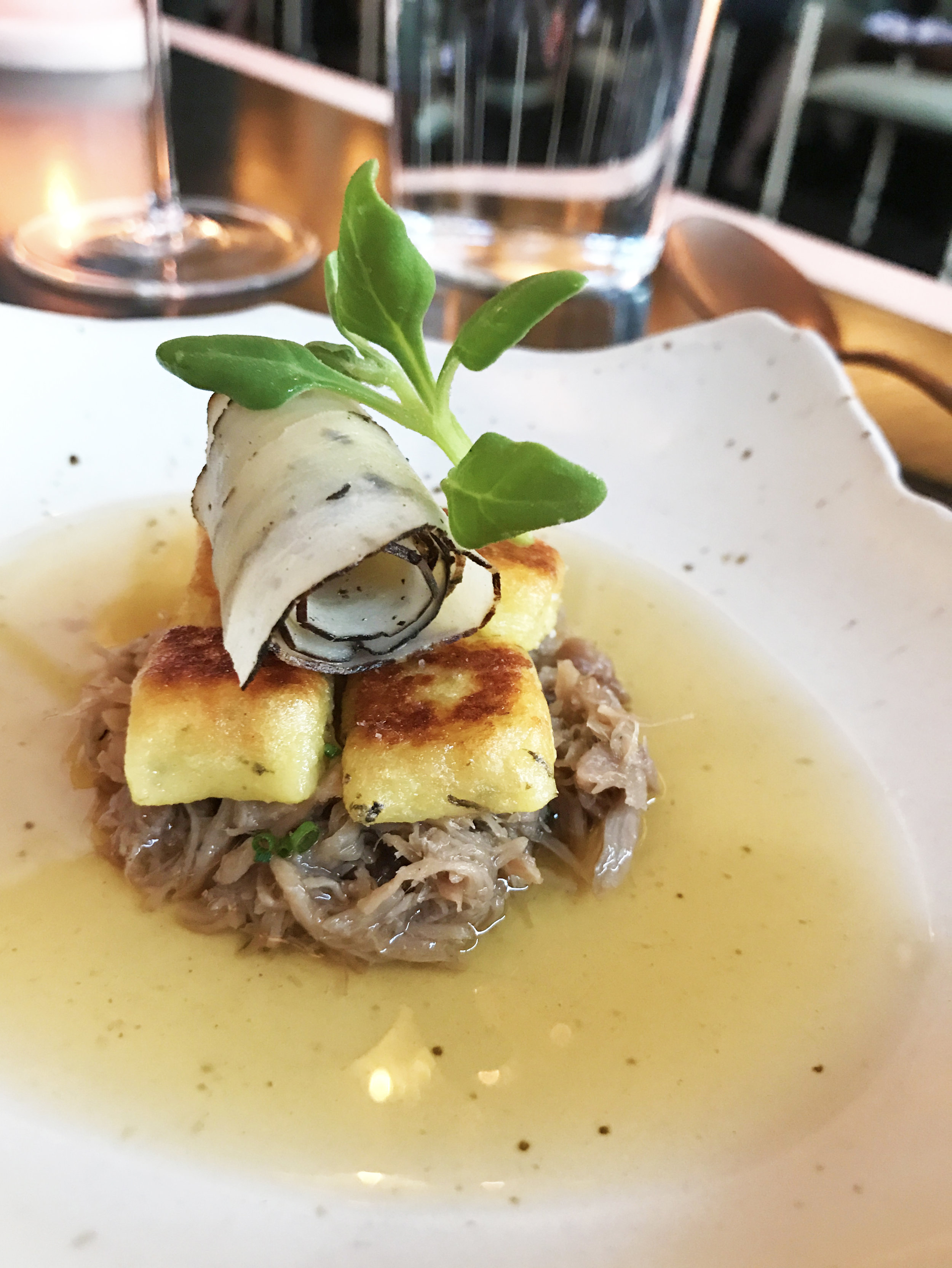 Gnocchi with smoked ham hock, salsify, and black truffle
