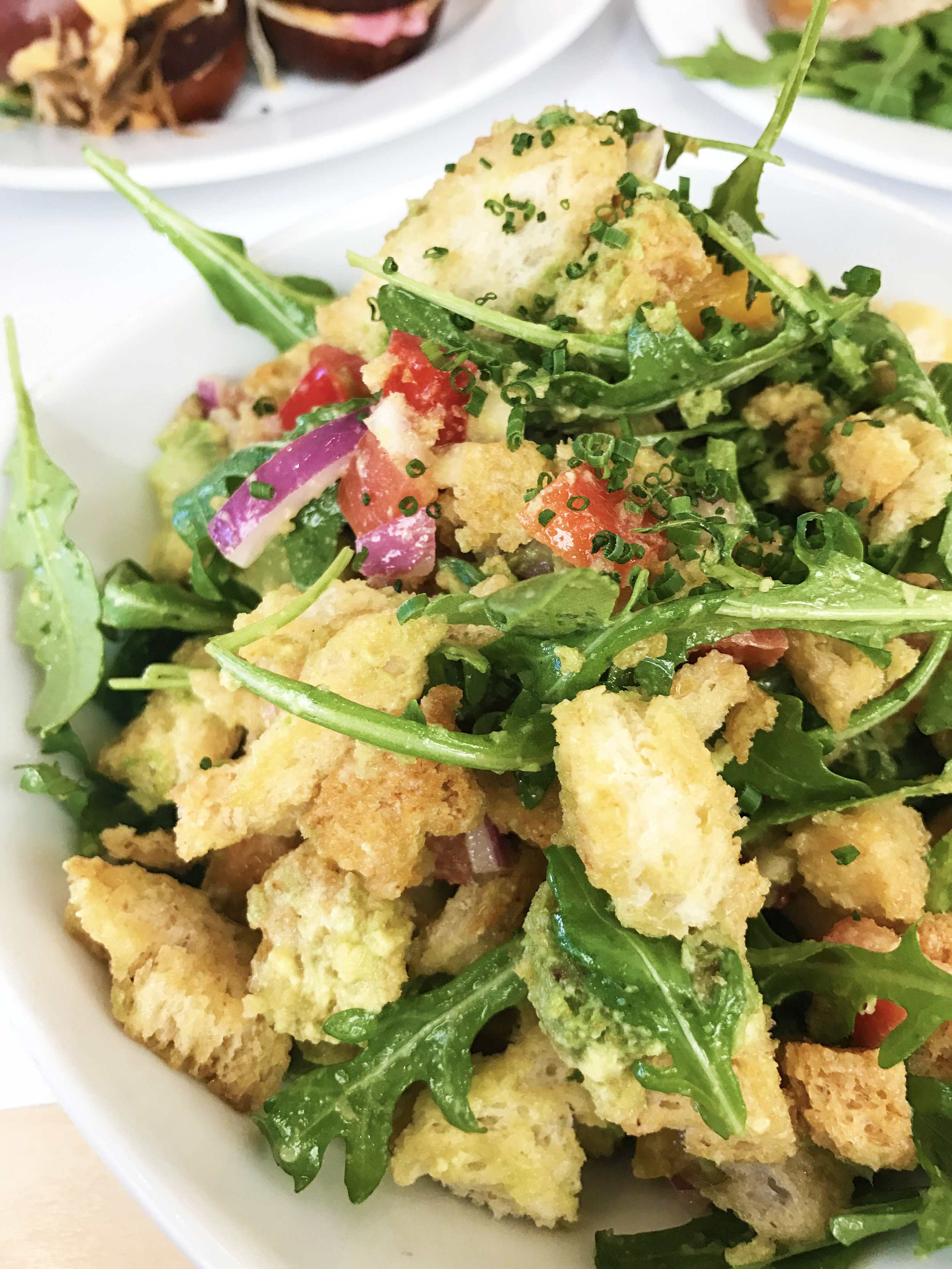Panzanella salad with toasted bread, avocado, and market vegetables