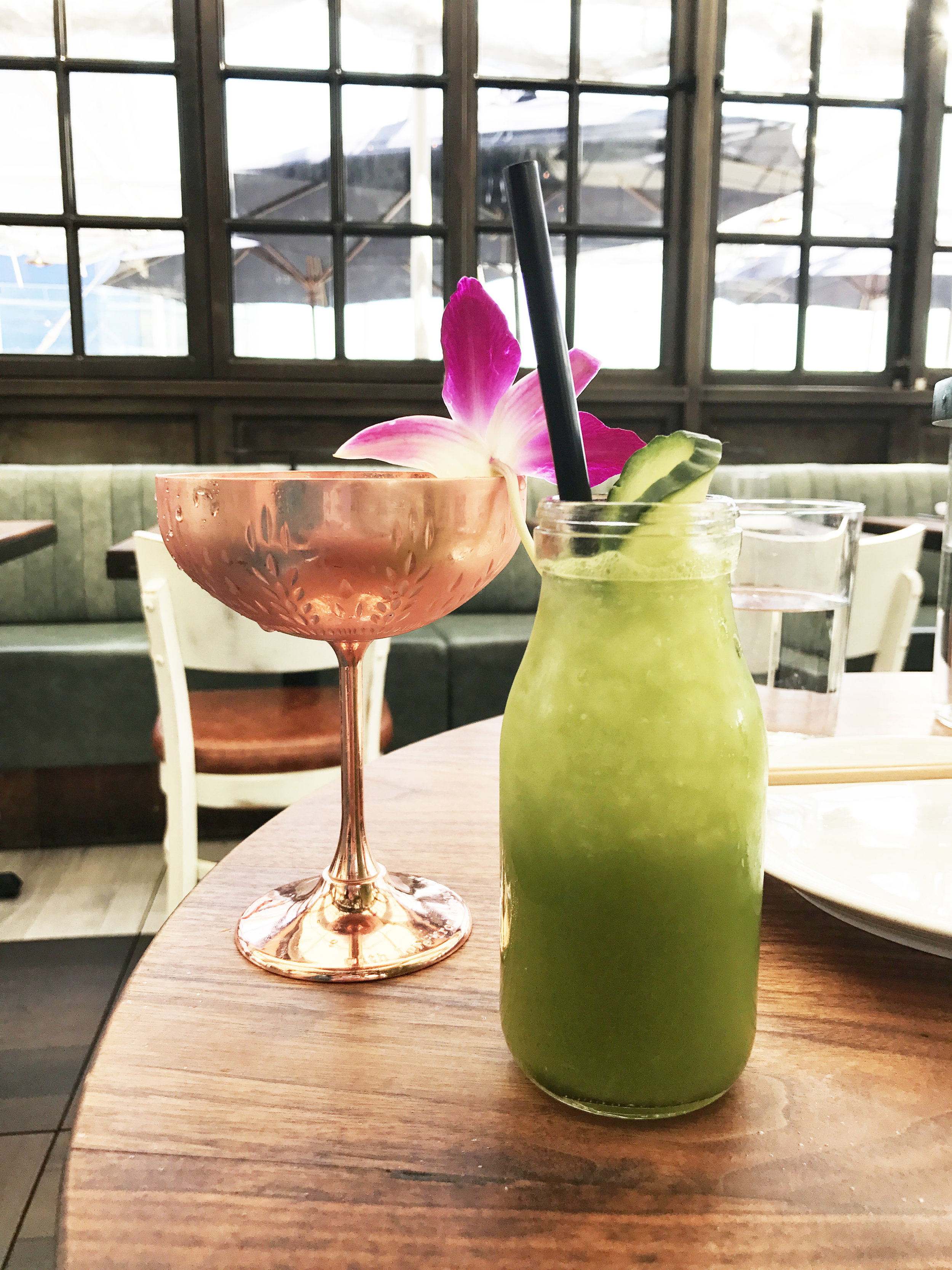 (left)  One Too Many, with strawberry-infused Absolut Elyx, Lillet Rose, coconut, avocado, rose, and lime  (right)  Detox Retox with Herradura Silver, matcha, fresh cucumber, mint, lime