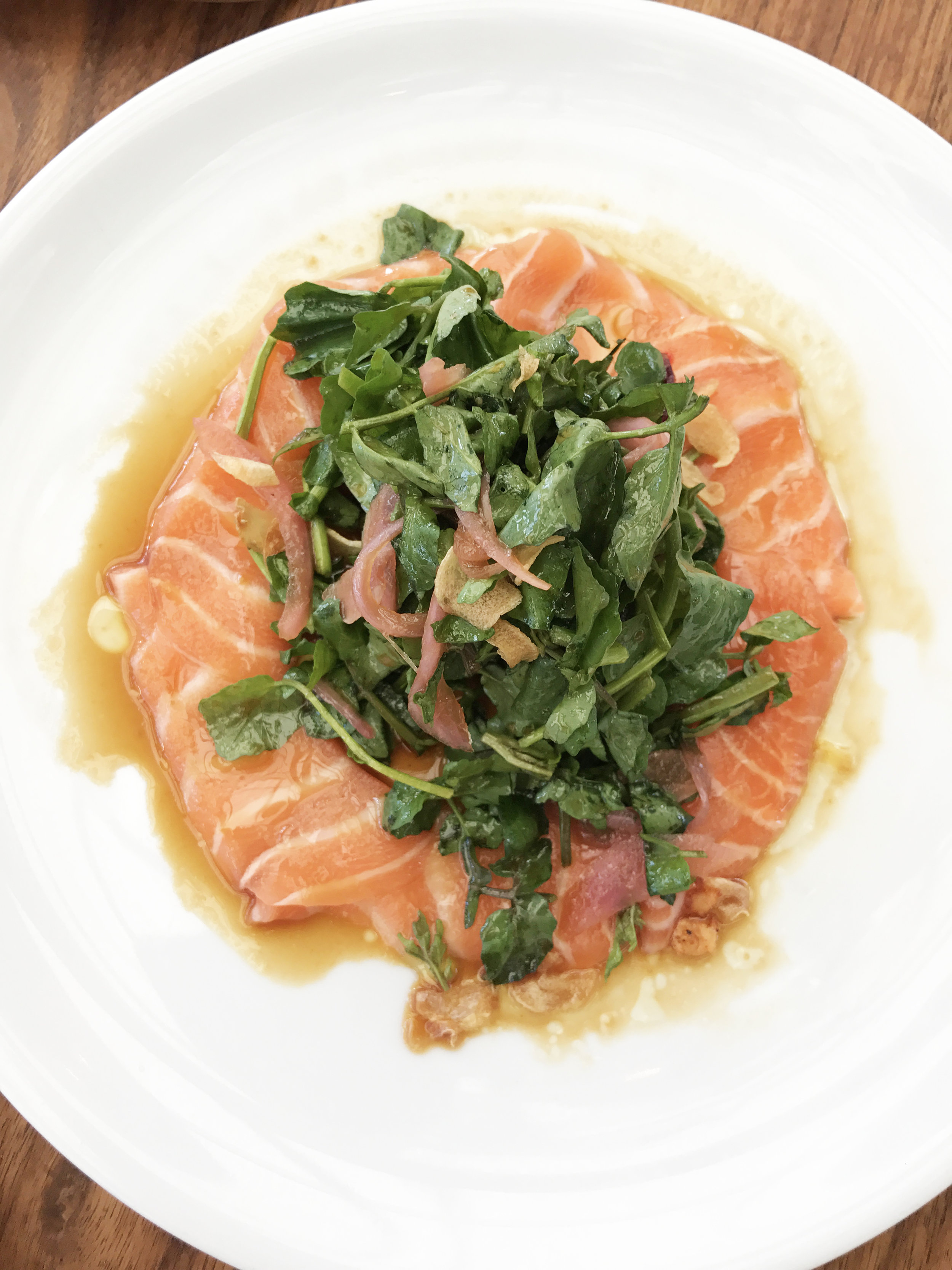 Salmon Belly Carpaccio with watercress, sweet and sour onion, and yuzu