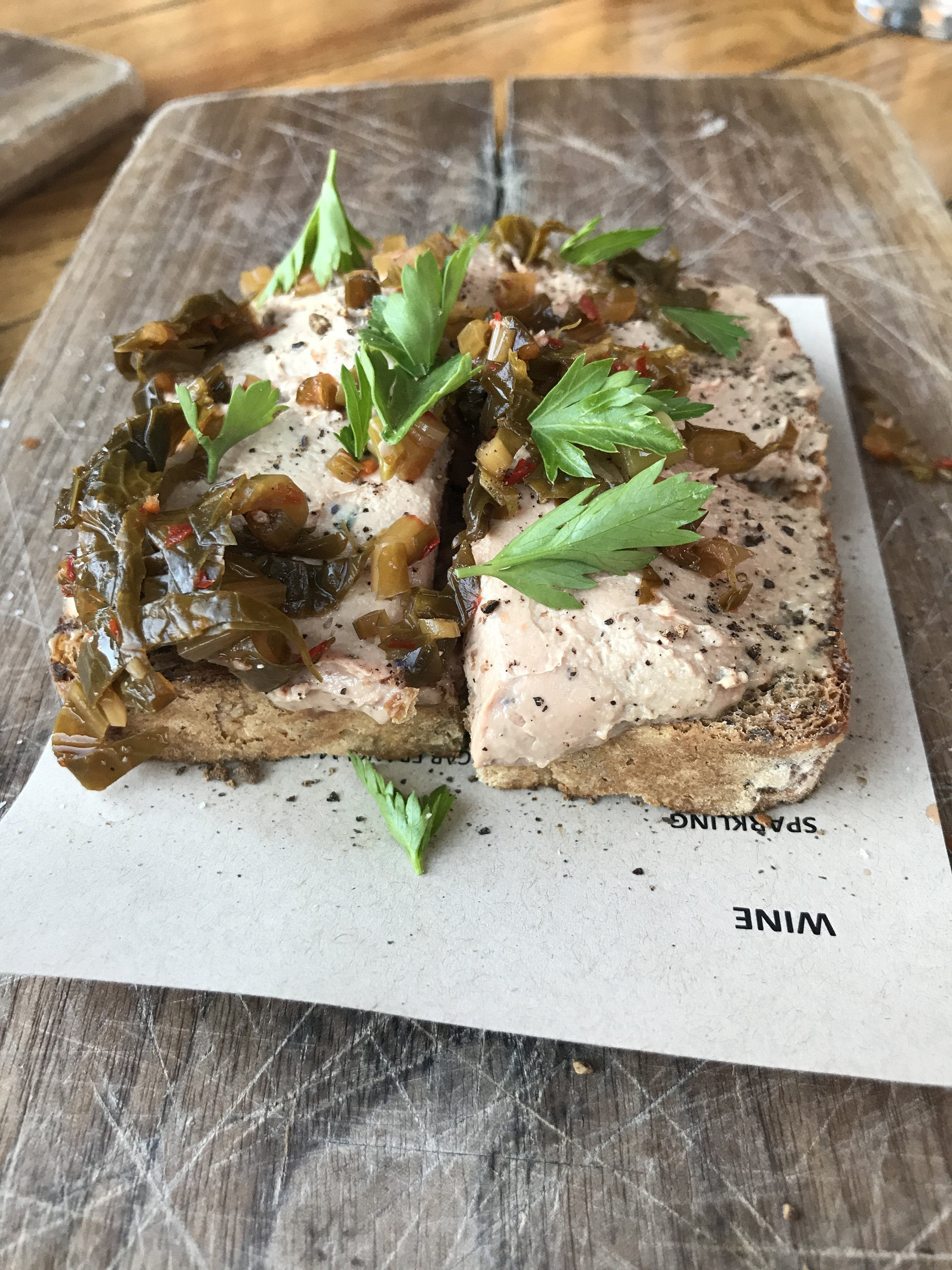 Chicken liver toast with spicy fermented greens and seeded toast
