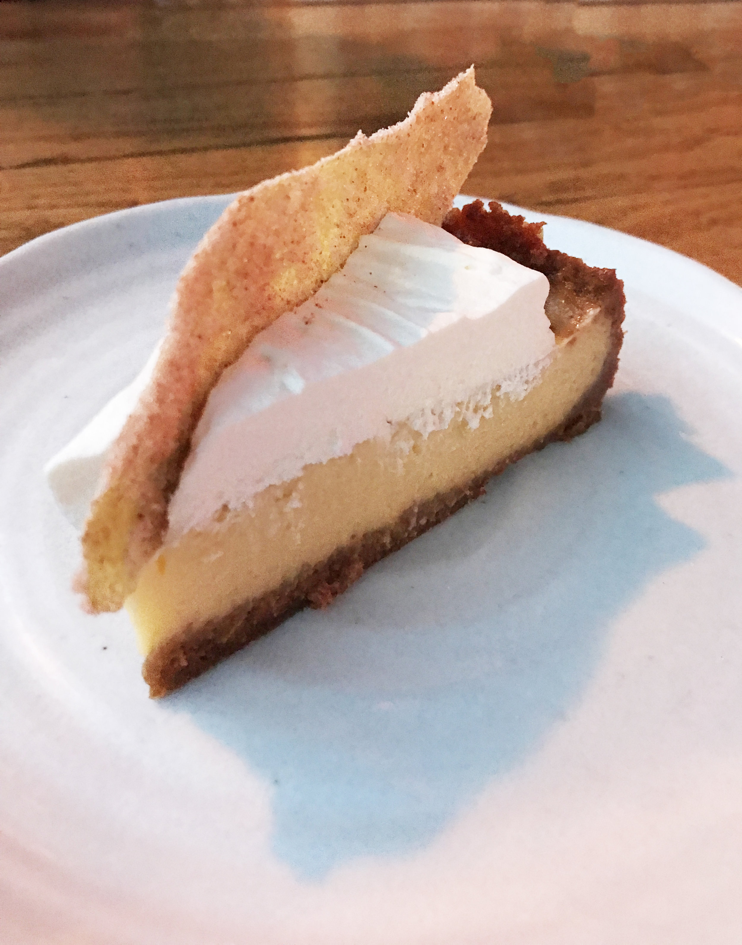 Salt's Cure grapefruit pie with salted graham cracker crust and whipped cream