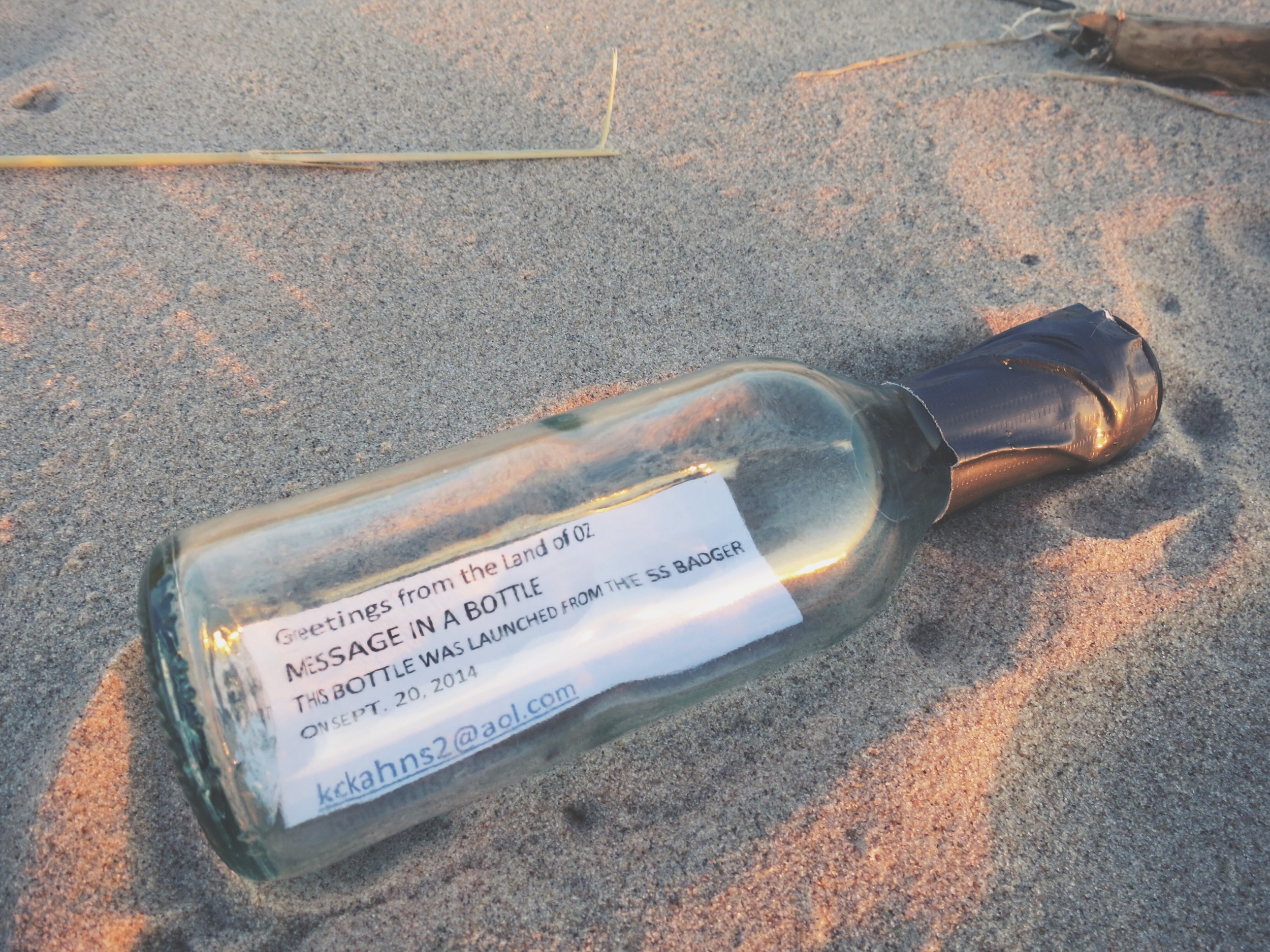 As if the trip weren't magical enough, I found a message in a bottle washed up on the shore as I was attempting to position myself directly between the setting sun and the rising full moon. Simply magic.