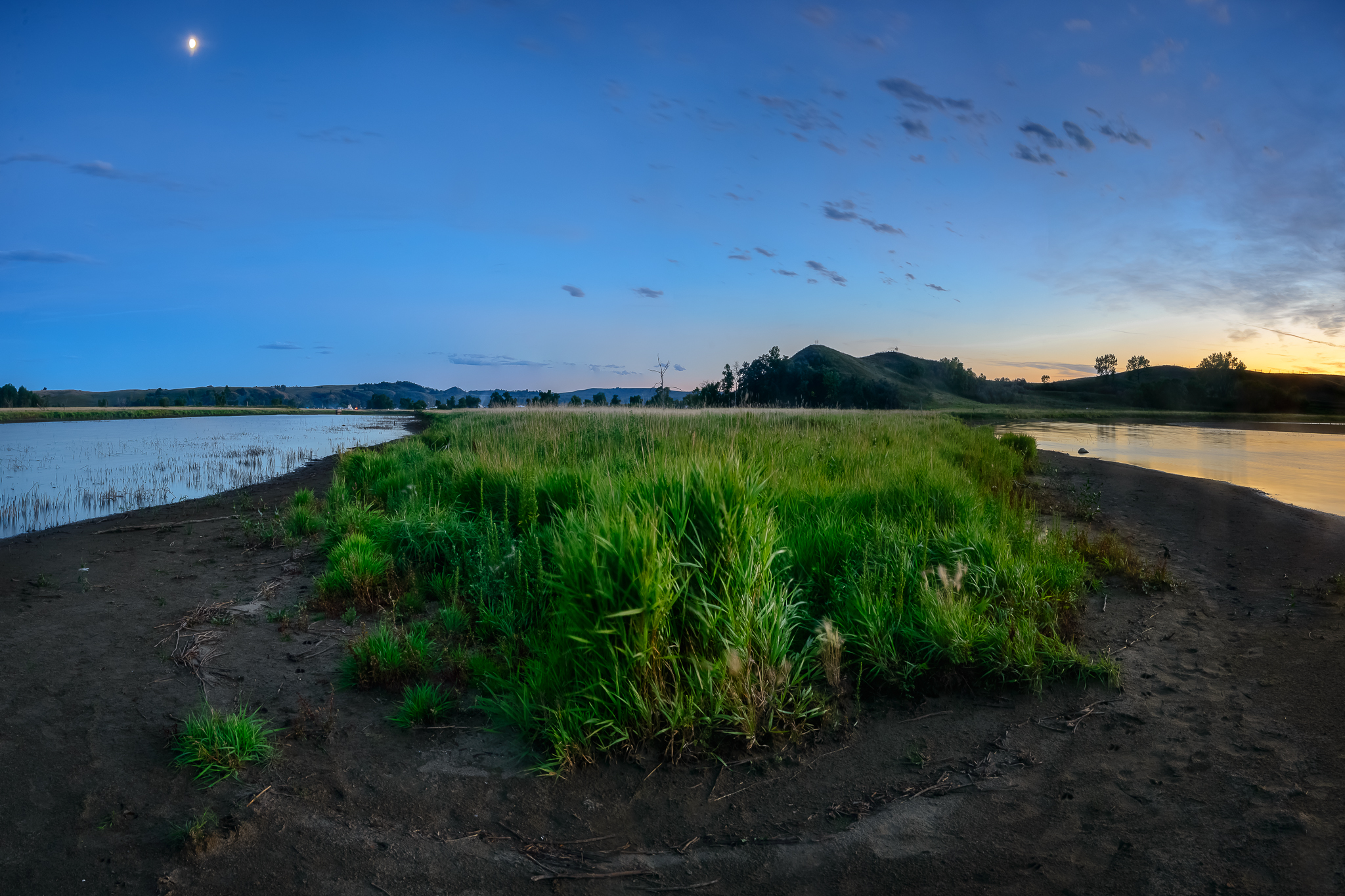Twilight creeps into a bend in the Cannon Ball River. Standing Rock Reservation Area, ND