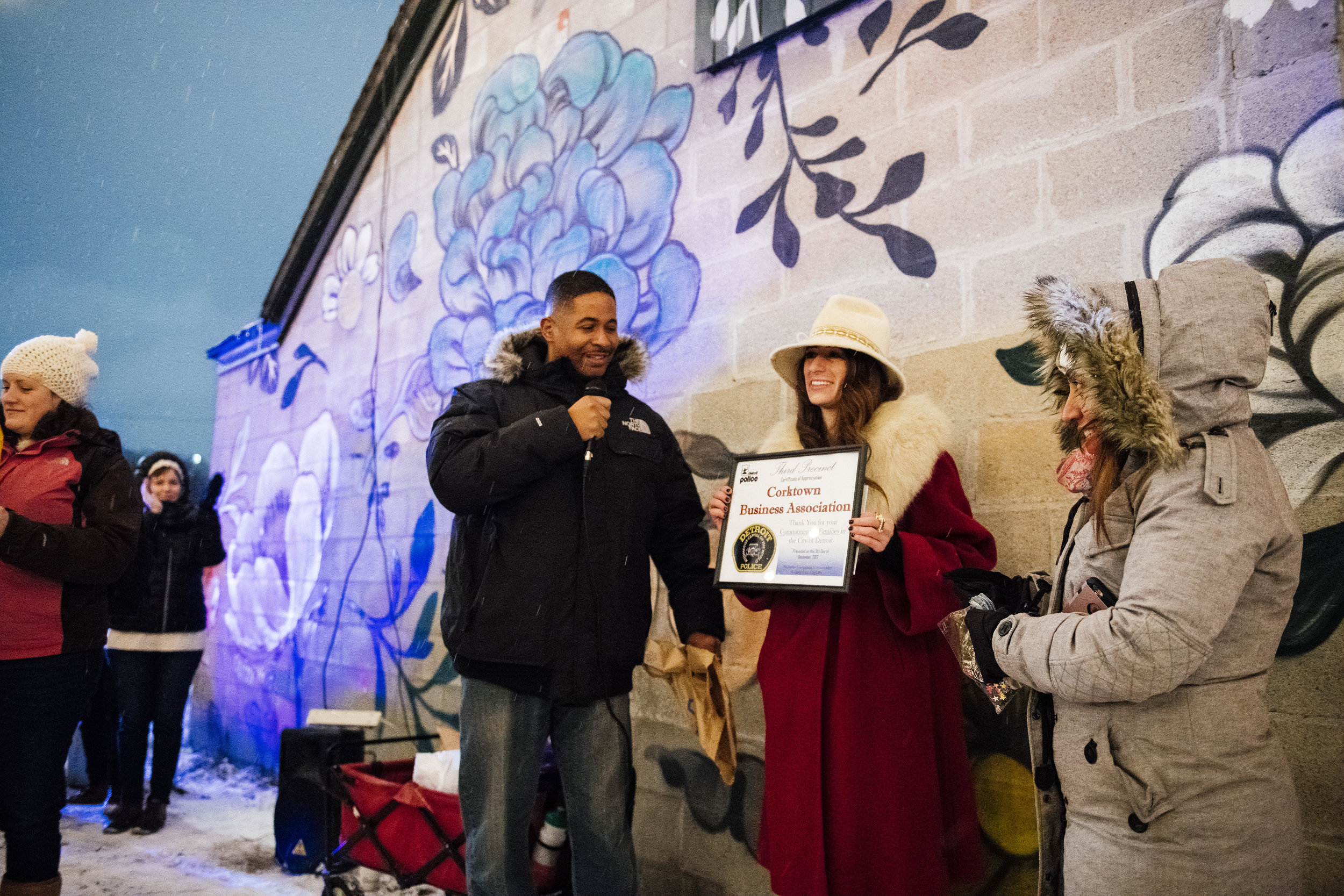 "Erin Gavle, Board Member and Event Director for the Corktown Business Association, receiving a Certificate of Appreciation on behalf of the CBA from the Detroit Police Department for a ""commitment to families in the City of Detroit."" / Photo by  eeberger"