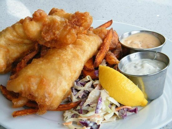 Greg's BEER BATTERED FISH & CHIPS - For the Batter: 1 cup self-rising flour, 2 tablespoons rice flour, 1/4 teaspoon baking powderFor the Fish: 4 (6 ounce) cod fillets, fully thawed if frozen, 2 tablespoons rice flour, or as needed, salt to taste, 12-16oz Habanero Amber, vegetable oil for fryingDirections: Whisk self-rising flour, rice flour, and baking powder together in a bowl. Freeze until ready to use. Pat fish as dry as possible. Cut pieces lengthwise to get eight 1-inch thick strips. Place rice flour on a plate and season with salt. Dust fish lightly with the mixture and shake off excess. Cover a plate with crinkled foil to make a quick drying rack; place fish on top. Heat oil in a deep-fryer to 375 degrees F (190 degrees C). Pour beer into the flour mixture and whisk, adding more as needed, until batter is the consistency of thick pancake batter. Dip fish pieces into the batter to coat; lift out and let excess drip off. Fry fish in batches until golden brown, dunking occasionally if needed, 3 to 4 minutes. Drain on paper towels. Serve immediately with fries, slaw and garlic aioli.