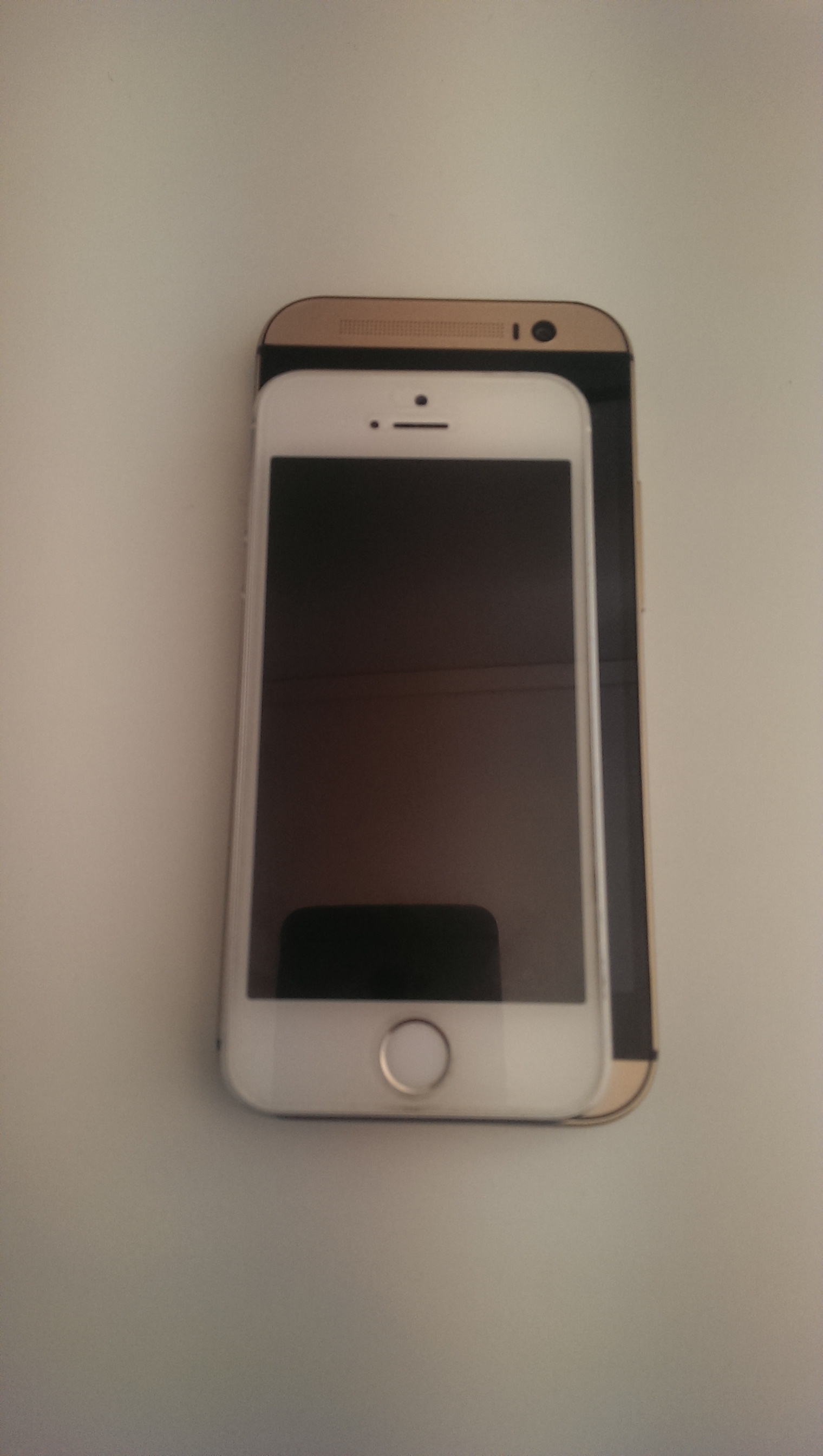 iPhone 5s on top of the HTC One M8