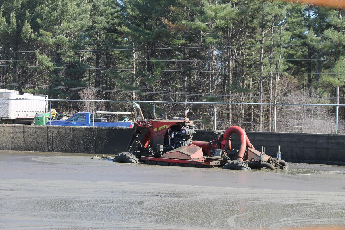 """Our """"Pit Crawler"""" stirring the manure pit to incorporate sand and manure so it can be spread together."""