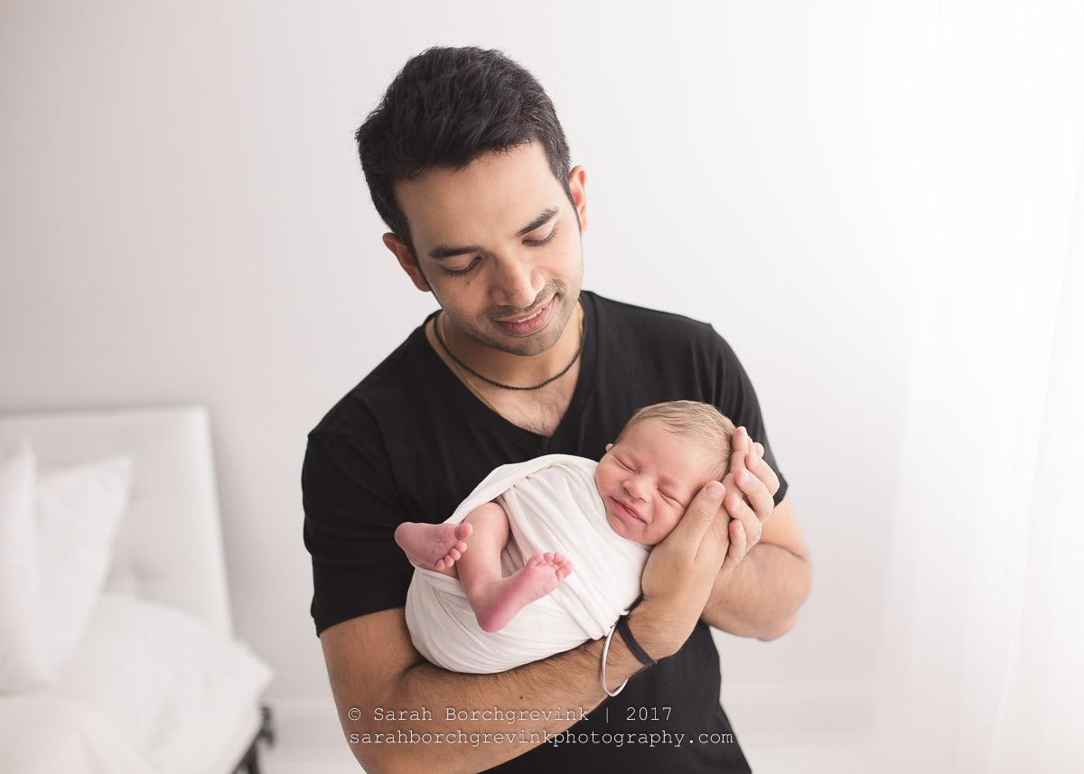 Dad and Newborn Posing during Posed Newborn Session
