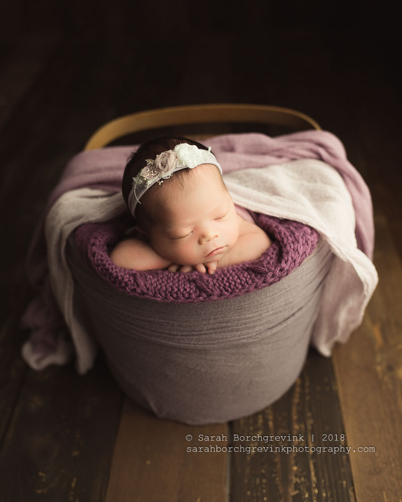 newborn photography pose in a bucket