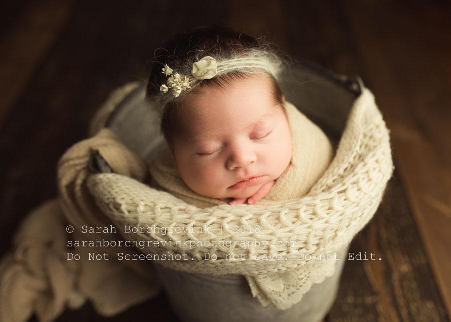 baby posing in bucket