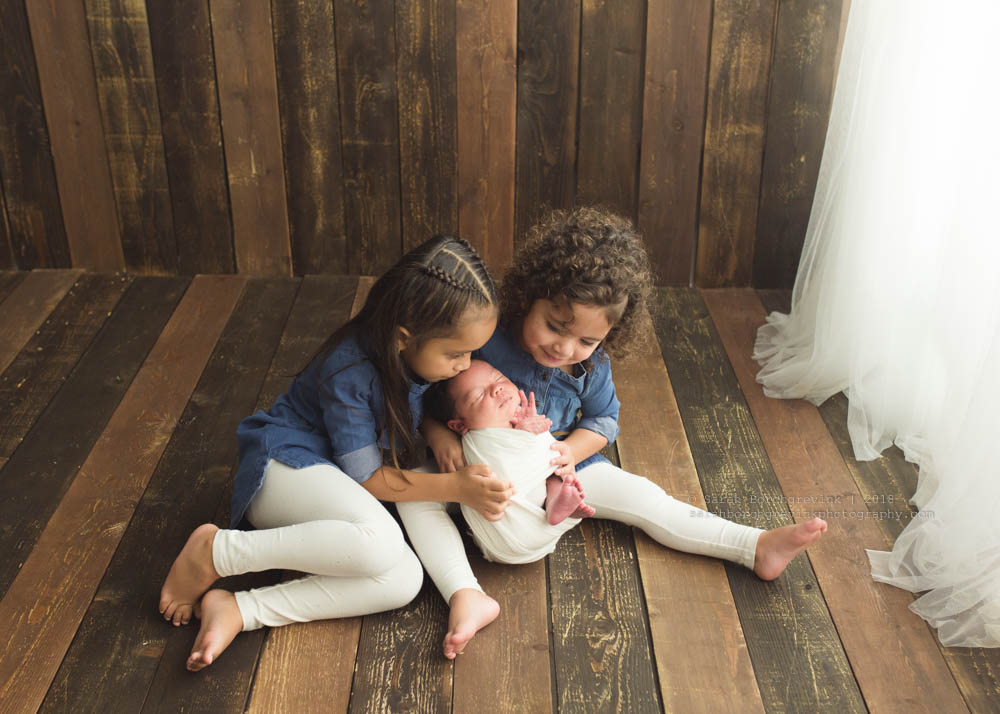 big sister photo ideas with newborn brother
