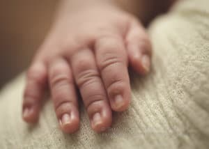 Macro images of newborn girl hands
