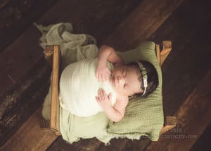 Green and sage vintage set up for newborn bed