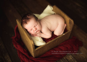 Baby Boy Posed on Vintage Bed