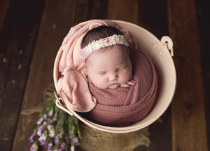 Baby in a Pink Bucket