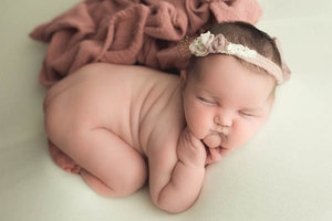 Baby Rolls during posed newborn session