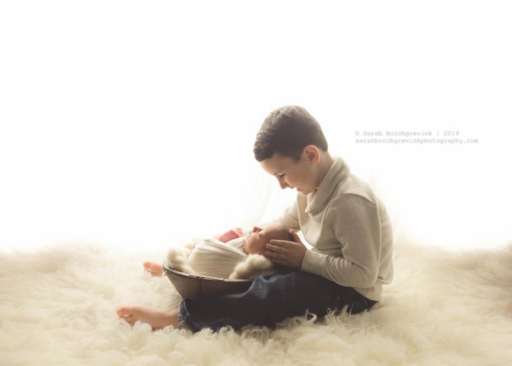 back-lit sibling and newborn photography setup