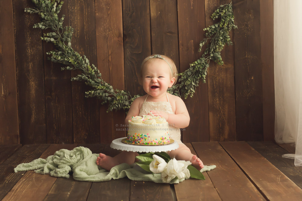 baby photography with plant decor and garland