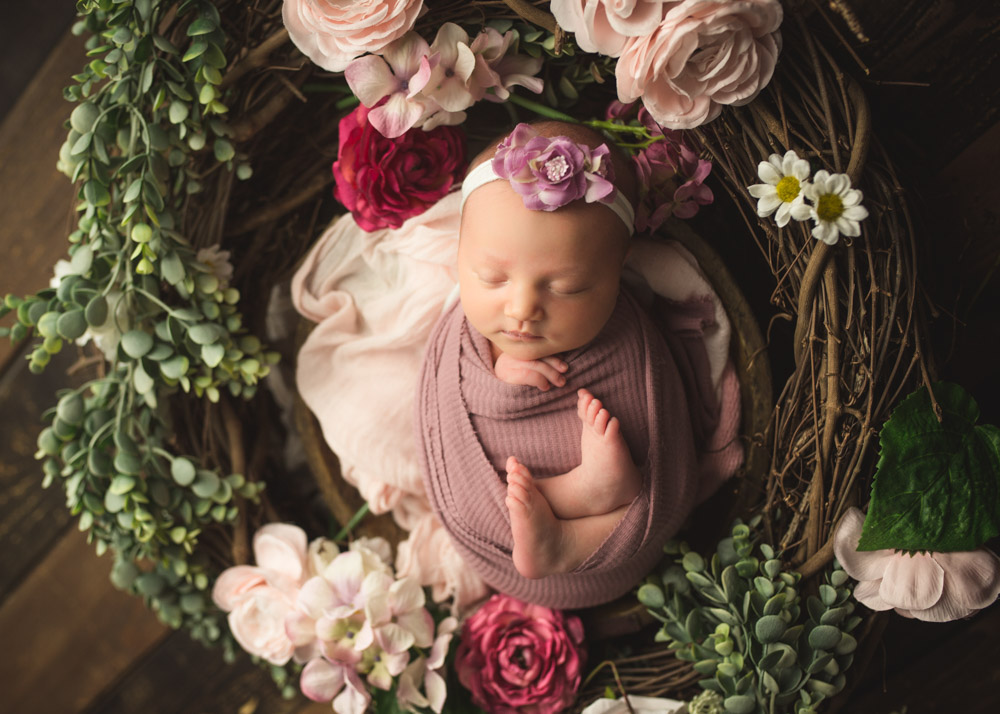 floral newborn session with newborn baby girl pictures