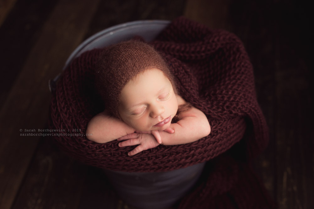 Baby boy in a bucket newborn session