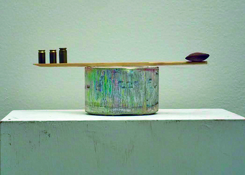 """""""Sama Vritti"""" cement, colored pencil, chopsticks, bullet shells, a dried pea smuggled home from Costa Rica"""