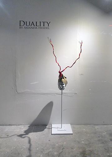 """Potent"" found mannequin, found gas mask, wire, yarn, spray paint"