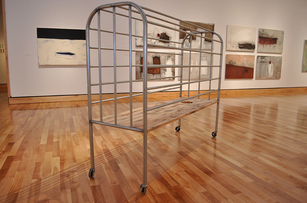 "Trap-bed . Steel, casters and reclaimed Douglas fir. 142cm x 58.5cm x 142cm. 2012. Photo from ""Michael Pittman: Haunted Half"" Exhibition at the Rooms Provincial Art Gallery, St. John's, NL, Canada."