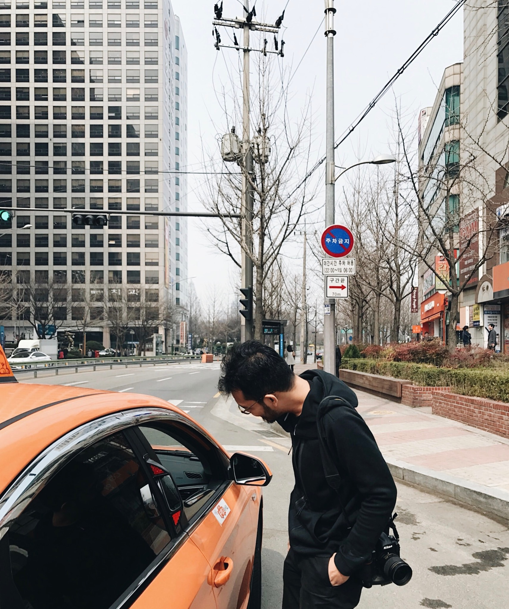 Regular taxi in Seoul, colored in orange. It took us around 5 minutes before the driver would agree to take us.