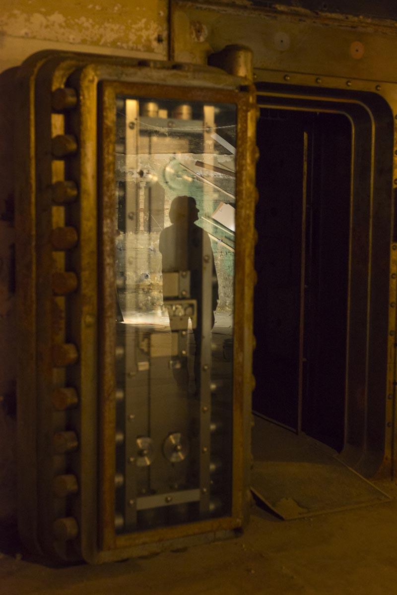 Reflection of Katie Bell's installation on the vault door.