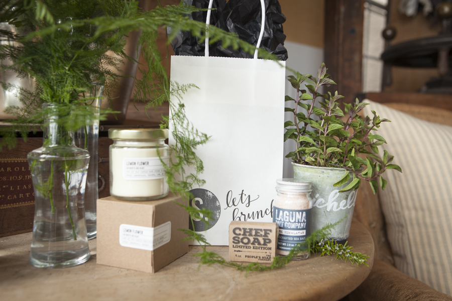 welcome bag with custom stamp and sponsored gifts including candle, chef soap, and artisan salt // SOURCED. laguna beach