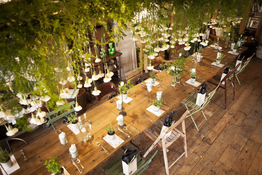 SOURCED. garden party brunch with overhead suspended greenery and drop carnations by Floral Fête