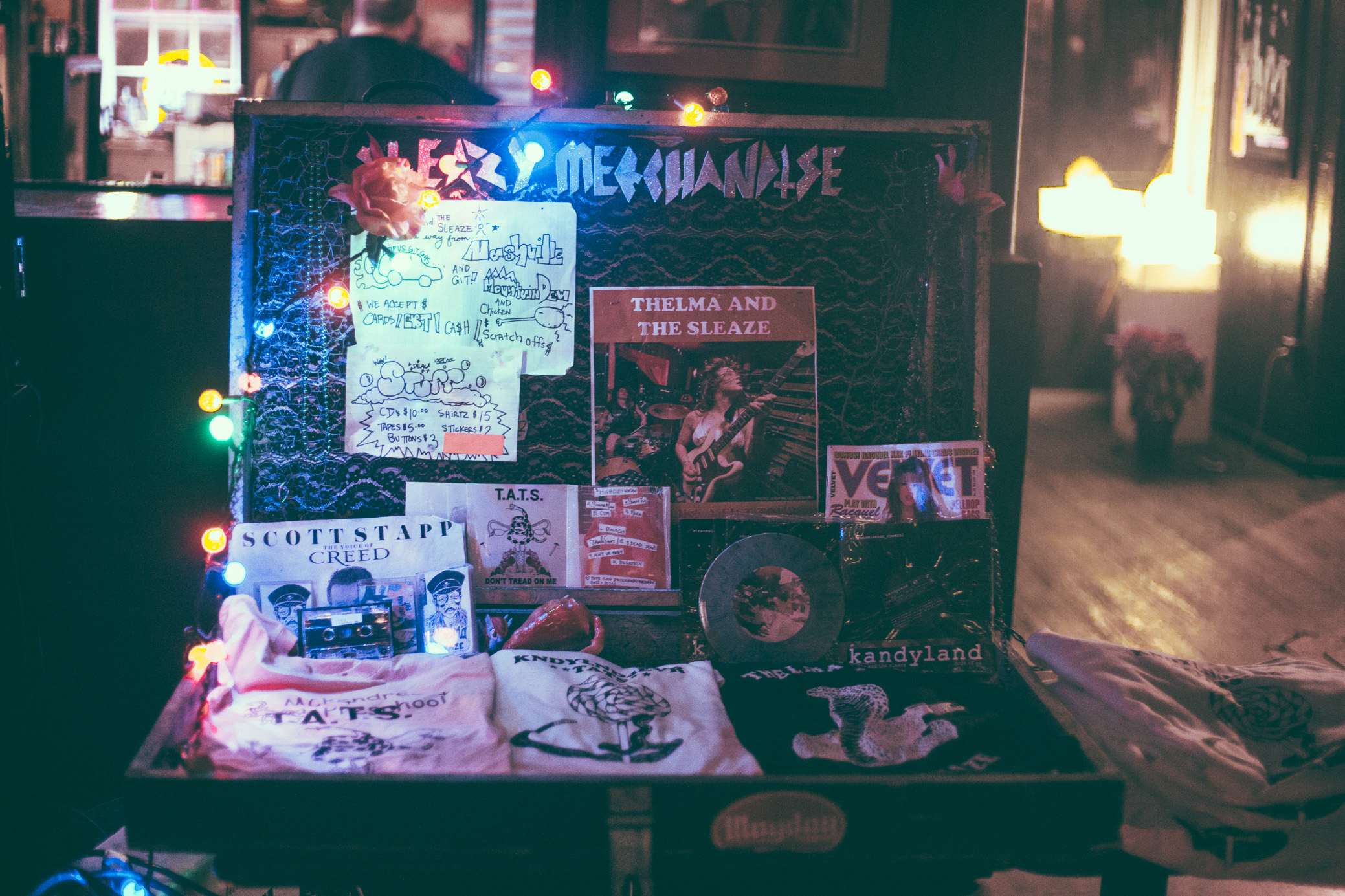 The merch table at the show by Thelma and The Sleaze at The Syndicate Lounge in Birmingham, Alabama on January 12th, 2017. / DSmithScenes