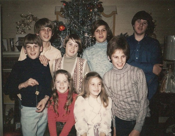 My father's side of the family - his brothers, sister and cousins at Christmas.   My dad is the one in the smashing grey turtleneck!
