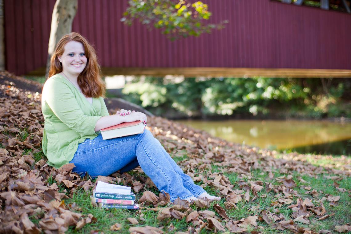 Senior-Portrait-Girl-Sitting-Grass-Books-Ken-Bruggeman-Photography-York-PA.jpg