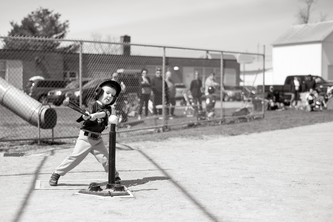 Ken-Bruggeman-Photography-York-PA-Young-Boy-Hitting-Baseball-Tongue-Out