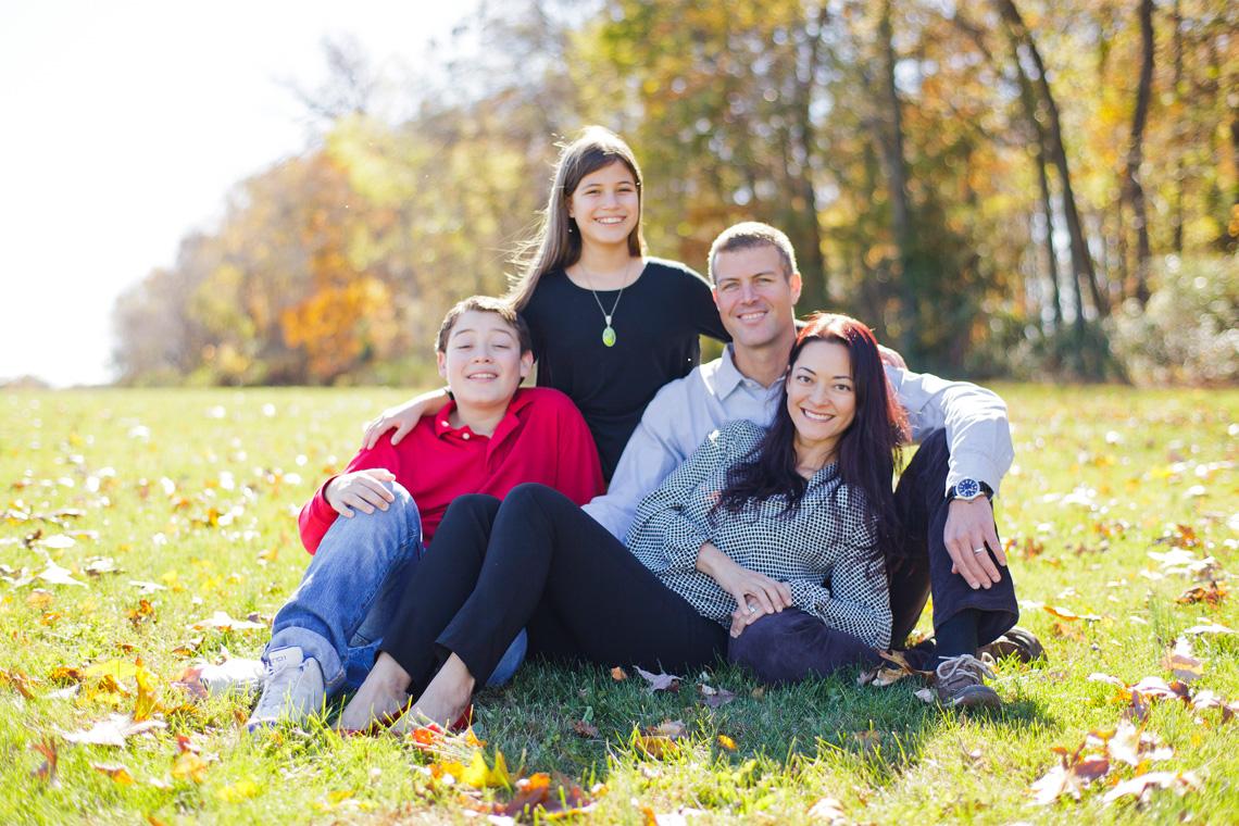 7-Family-Portrait-Sitting-Smiling-Grass-Colorful-Leaves-Ken-Bruggeman-Photography-York-PA.jpg