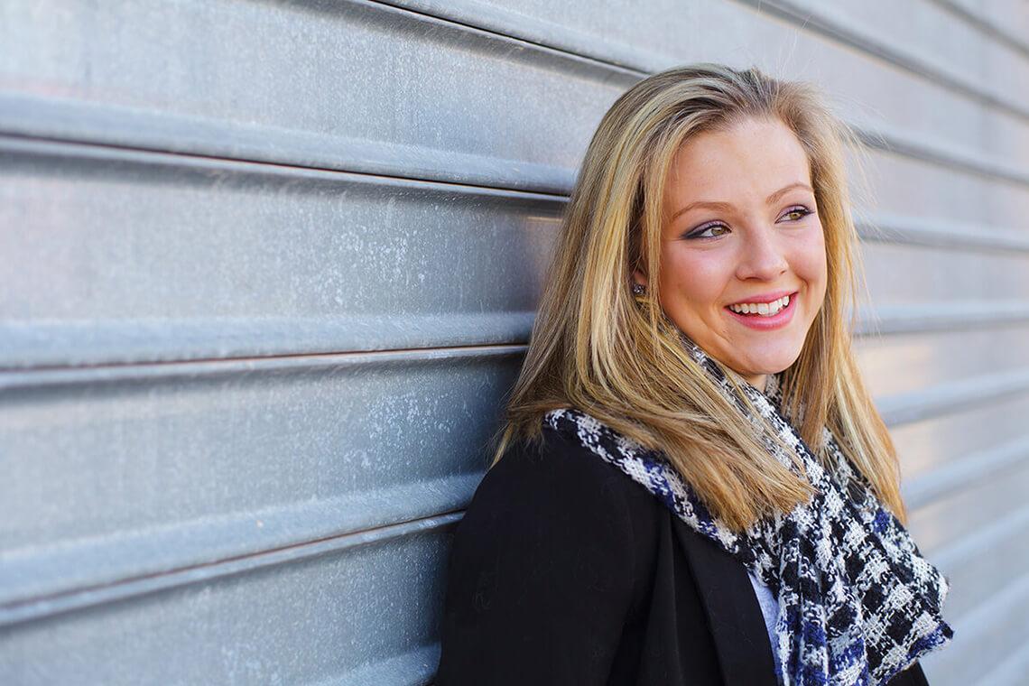 8-Ken-Bruggeman-Photography-Senior-Portrait-Photographer-York-PA-Woman-Smiling-Corrugated-Metal-Door.jpg