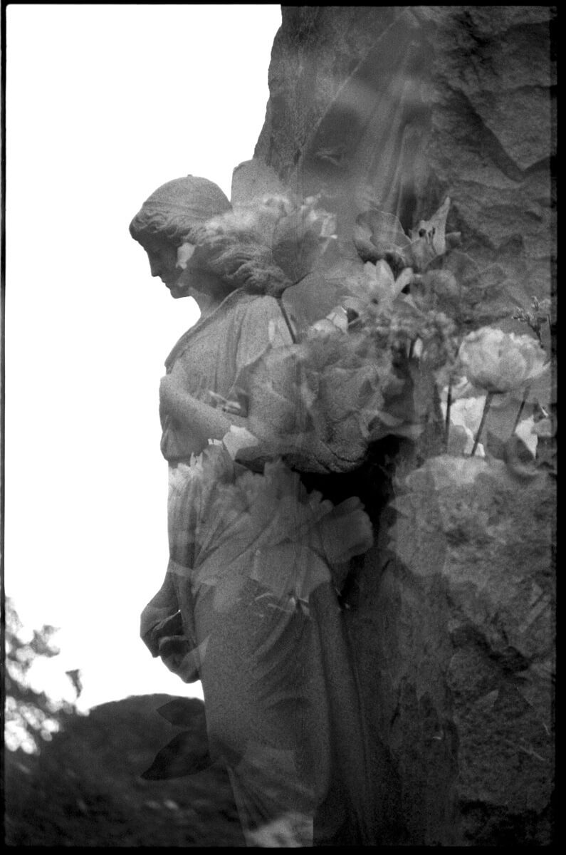 This is a double exposure of my favorite statue in the cemetery and some flowers. This is the same statue as the first photo in this post.