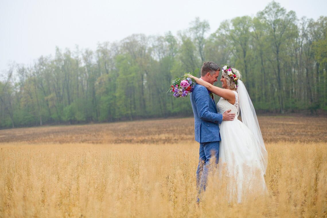 21-Wedding-Ken_Bruggeman-Photography-York-PA-Bride-Groom-Smiling-Field-Embracing.jpg