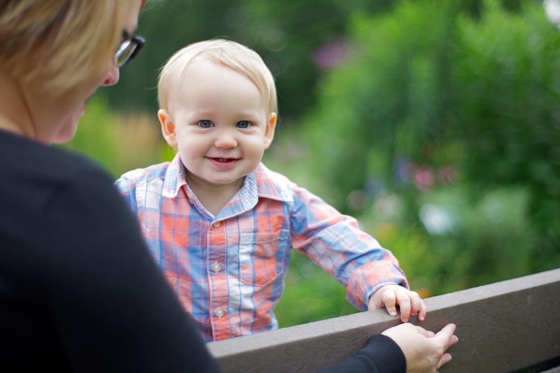 3-Ken-Bruggeman-Photography-York-PA-Family-Baby-Standing-Bench-Smiling-Colorful.jpg