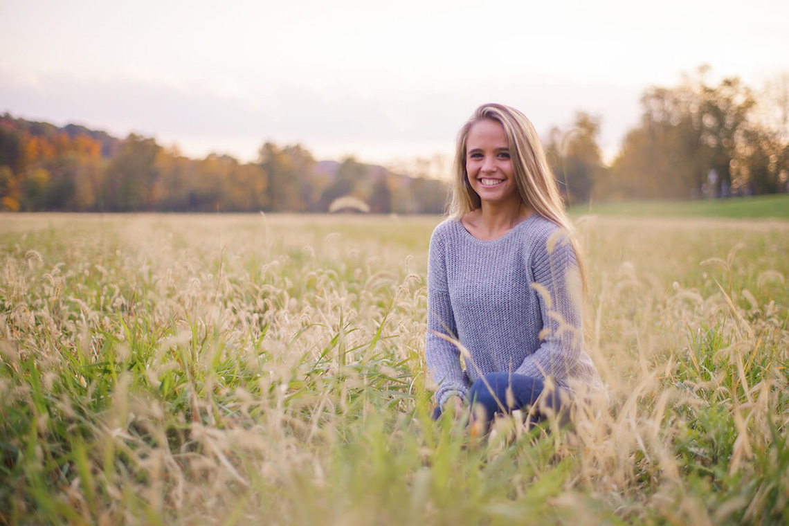 12-Family-Photographer-York-PA-Ken-Bruggeman-Smiling-Young-Woman-Field.jpg
