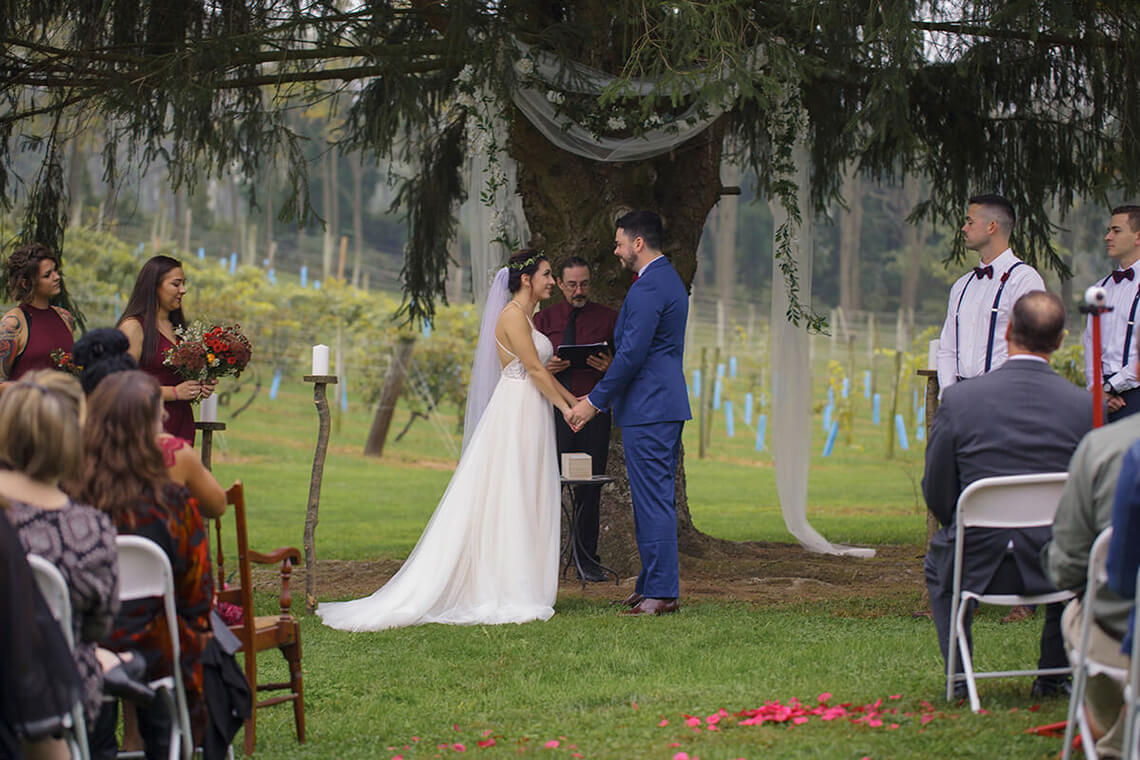 1-Wedding-Photographer-York-PA-Ken Bruggeman-Photography-Couple-Holding-Hands-Alter.jpg