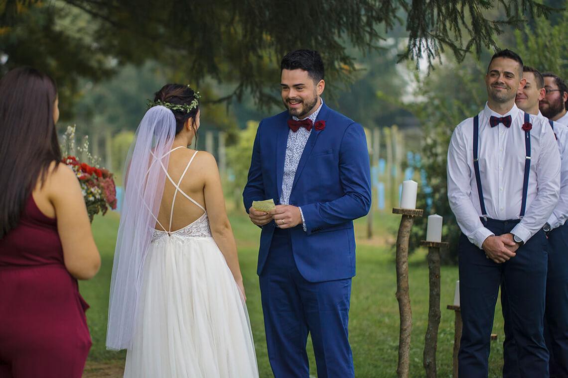 4-Wedding-Photographer-York-PA-Ken Bruggeman-Photography-Groom-Smiling-Reading-Vows.jpg